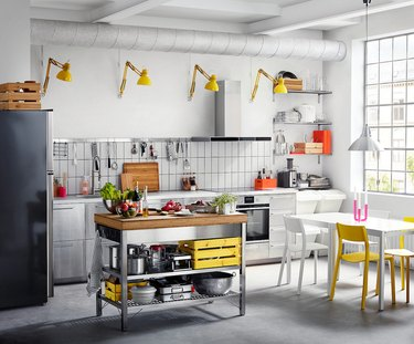 Stainless steel and bamboo IKEA kitchen island in industrial kitchen