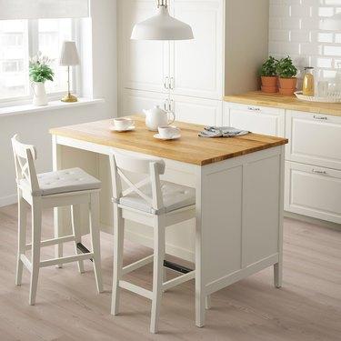 White and oak IKEA kitchen island in modern white kitchen