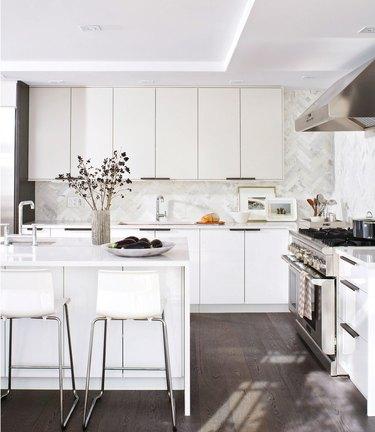 Kitchen with herringbone pattern stone tile backsplash