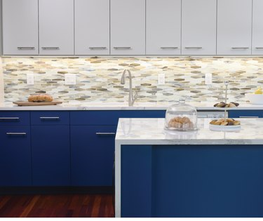kitchen space with gray and navy blue cabinets