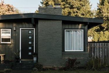 Gray painted home with black door
