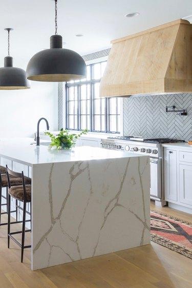 Kitchen with matte finish stone tile backsplash