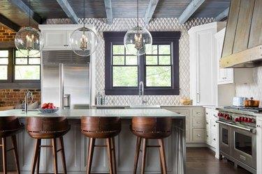 Kitchen with geometric stone tile backsplash