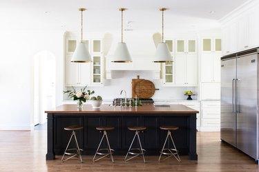 wood paneled gray kitchen island in modern white kitchen