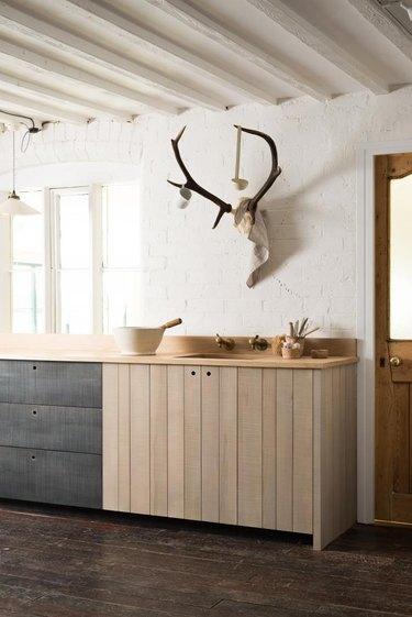 Kitchen with painted stone tile backsplash