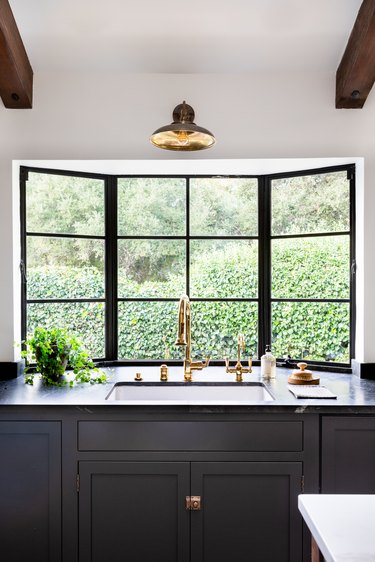 white kitchen with black counters and cabinets