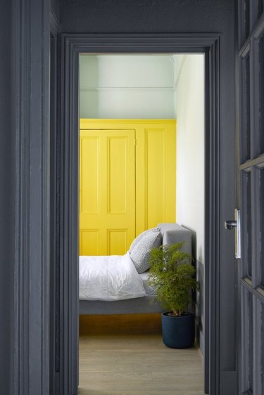 bright-yellow accent color in a hip London rental bedroom