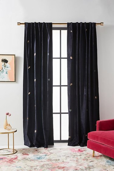 black velvet curtains with embroidered details