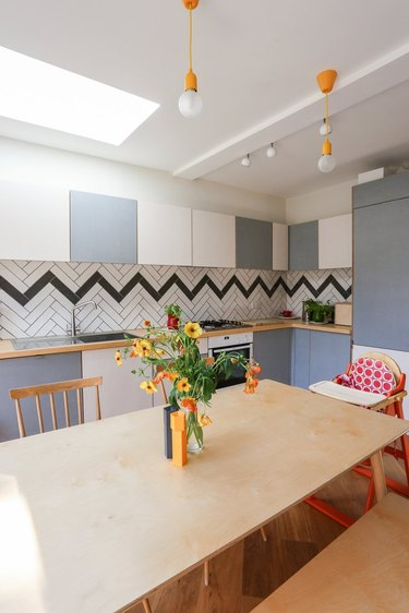 chevron tile backsplash in a fun, colorful London kitchen