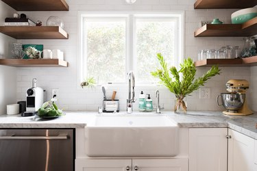 bright white kitchen with farmhouse sink, gray counter
