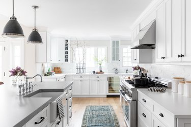 bright open concept kitchen with white walls