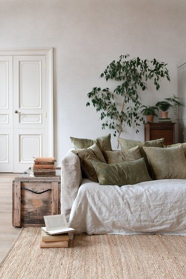 natural decor in a gray room with linen sofa and green pillows