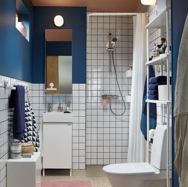 IKEA bathroom lighting idea with blue walls and white tile