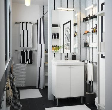 IKEA bathroom lighting idea with striped tile walls and white vanity