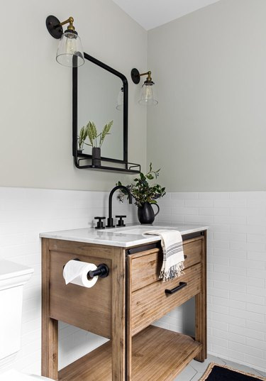 wooden sink in bright white bathroom