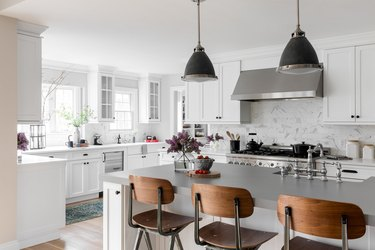 stainless steel kitchen and wooden chairs in kitchen
