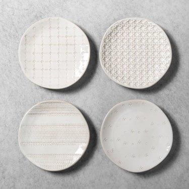 four small white plates