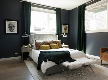 black walls in bedroom with white bed linen