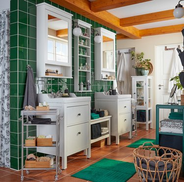 IKEA bathroom lighting idea with green tile wall and wood ceiling beams