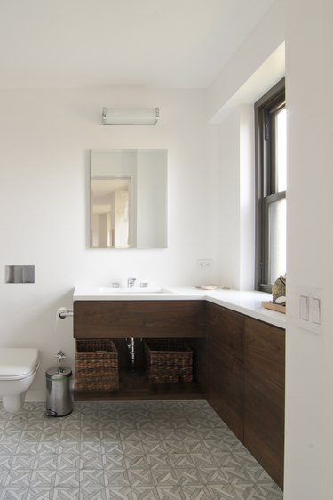 New York City apartment bathroom with L-shaped vanity
