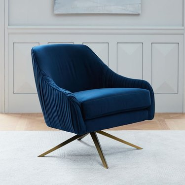 blue velvet art deco chair with brass legs from West Elm