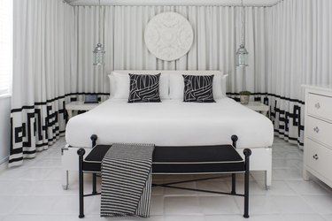 black and white hollywood style bedroom with trellis pattern