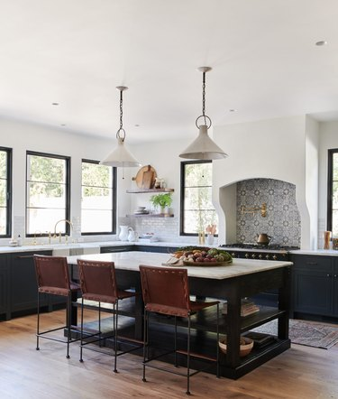 spanish-style kitchen with black island
