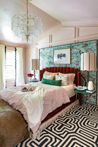 art deco bedroom with a graphic rug, hand painted screen