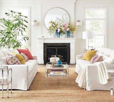 Pottery Barn slipcovered sofas in bright living room