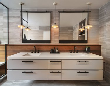 modern bathroom with square mirrors over double vanity