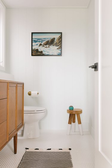 Bathroom with vintage artwork