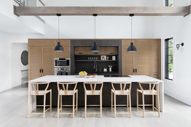 modern kitchen with black island