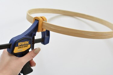 Hand clamp gripping wooden hoops