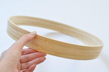 Wooden hoops glued together.