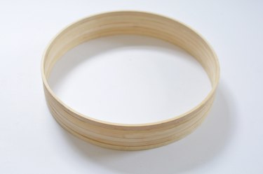 Wooden hoops glued togther to create a circular frame.