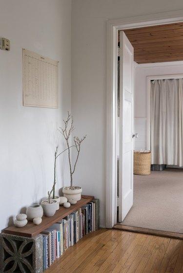 minimalist apartment with porcelain ceramics on a low bookshelf