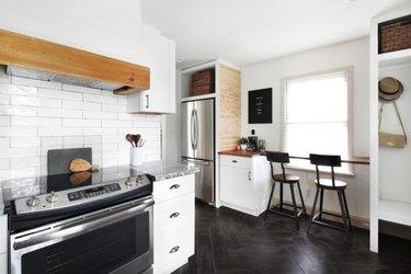 Herringbone black tile farmhouse kitchen floor