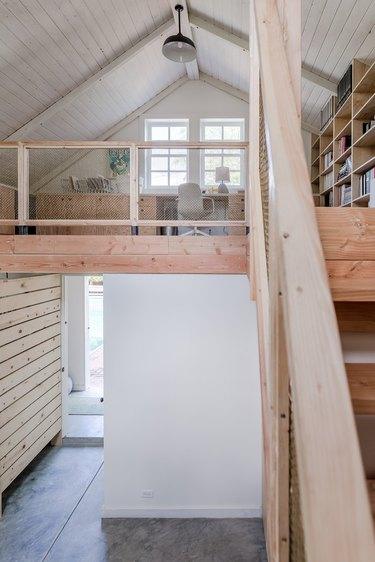 barn-style home with office and library in loft
