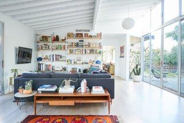 light, bright midcentury living room interior with vintage furniture