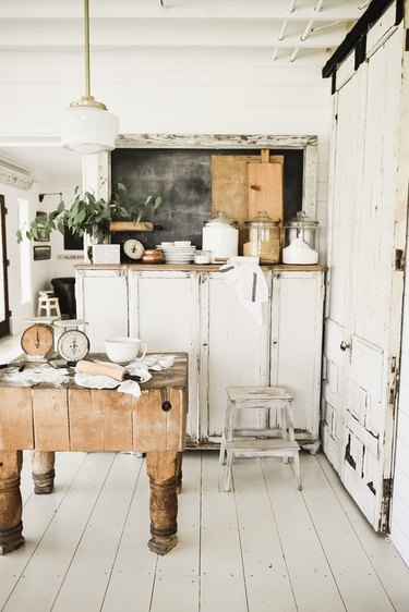 White painted wood farmhouse kitchen floor