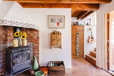 topanga canyon interior with terra cotta tile flooring and beamed ceiling