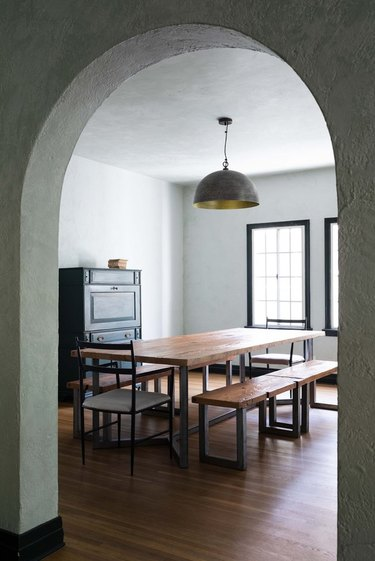 arched doorway leading to a moody dining room