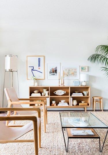 midcentury modern family room with light oak midcentury modern bookshelf and angled standing lamp.