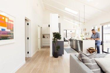 sleek modern farmhouse kitchen living room interior with skylight
