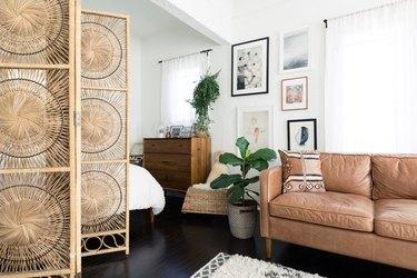 studio apartment boho minimalist design with rattan room divider