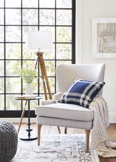 Chair with throw pillow in traditional living room