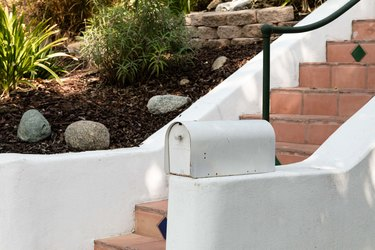 Mailbox next to stairs and yard on a slope