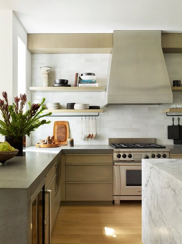 thick concrete countertops in tactile kitchen with marble island