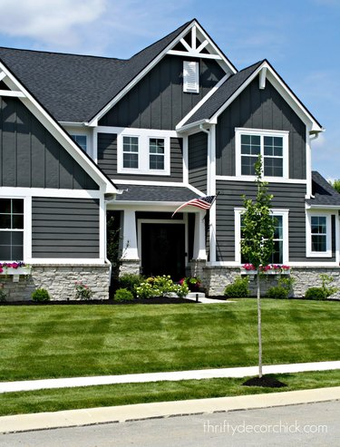 Dark gray Craftsman home exterior with white trim and gables