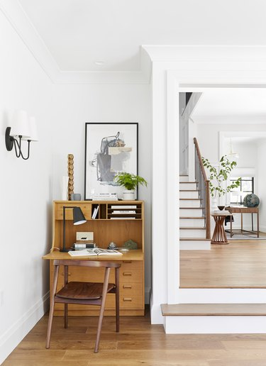 Work space and hardwood floors in traditional living room